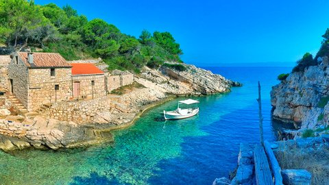Bay with old stone houses and fishing boat, Lastovo island, Croatia